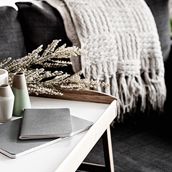 Cozy home scene with blanket over back of couch